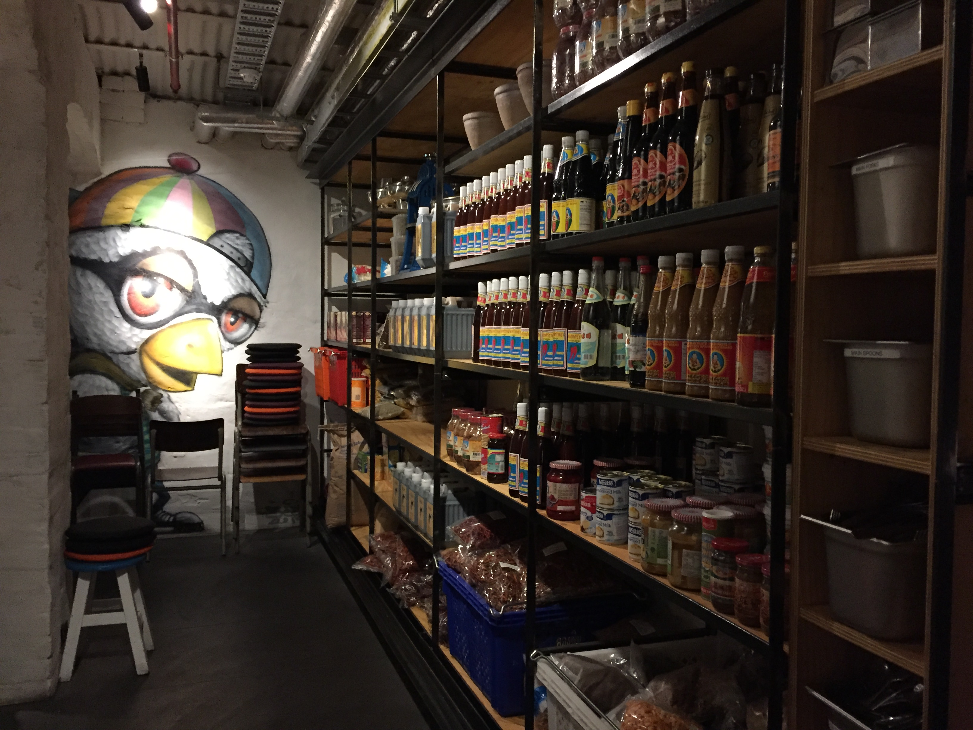 Sauce storage area with duck painting on wall at Longchim Restaurant in Perth