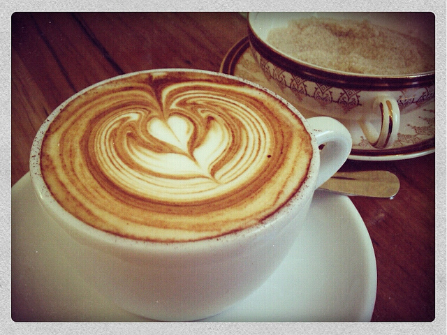 Cup of coffee with tulip decoration